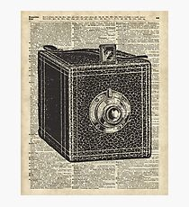 Antique Cube Camera Over Old Encyclopedia Page Photographic Print