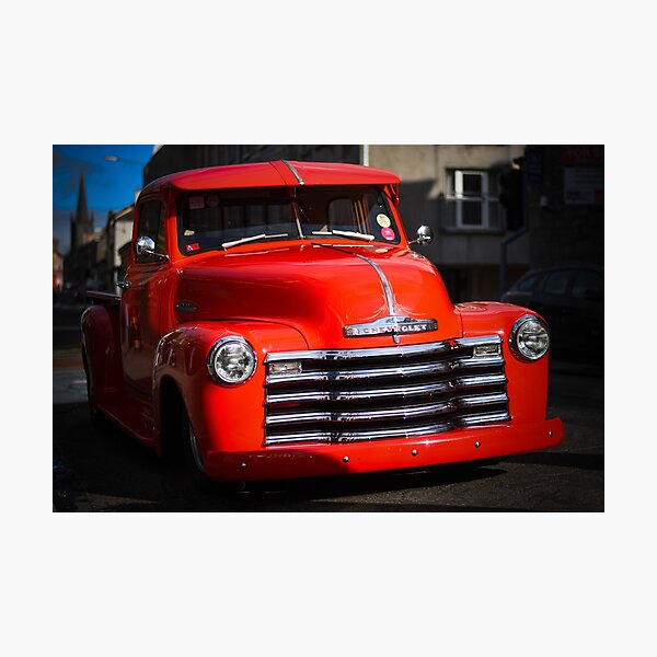 Red Chevrolet In The Street Photographic Print