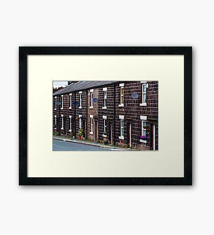 Cottages of blackened stone Framed Print