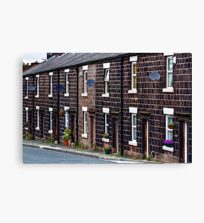 Cottages of blackened stone Canvas Print