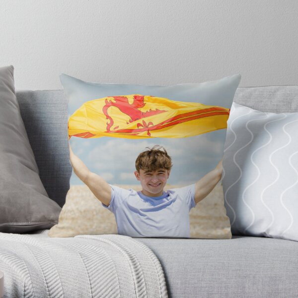 A young man with a Lion Rampant of Scotland flag Throw Pillow