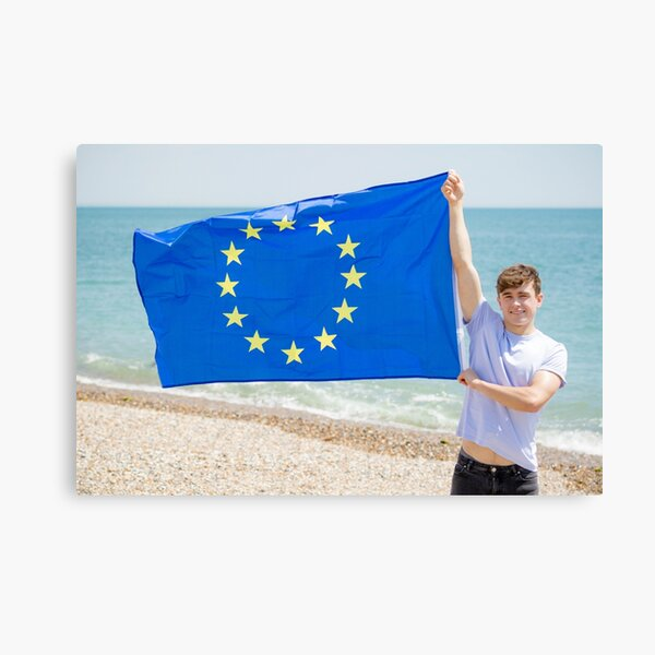 A young man holding the flag of The European Union Canvas Print