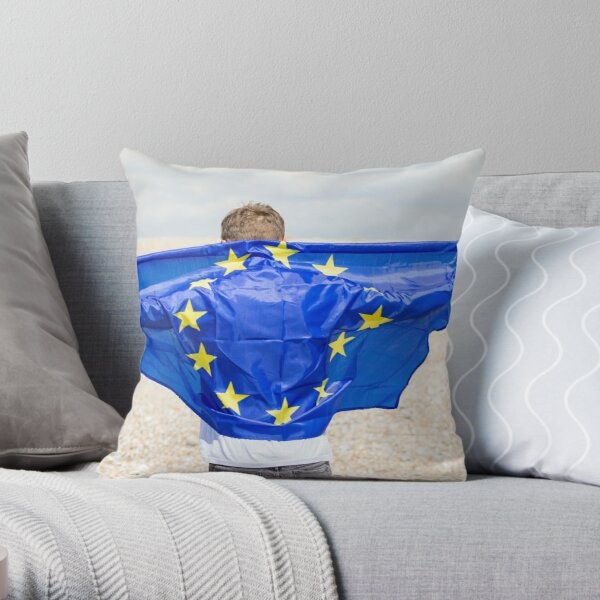 A young man holding the flag of The European Union Throw Pillow