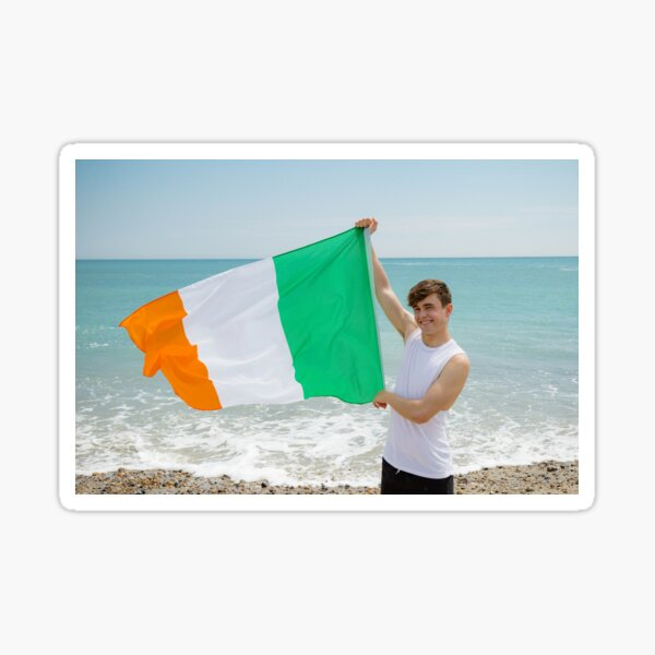 A young man holding the Irish Flag Sticker