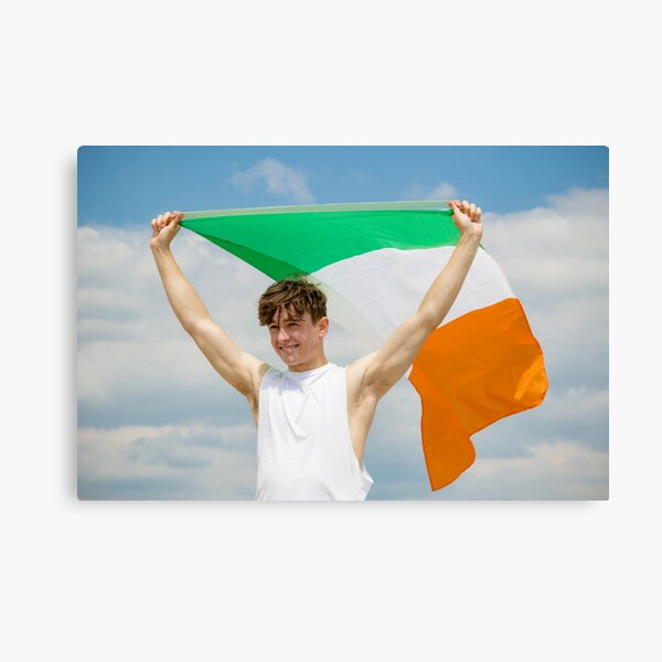 A young man holding the Irish Flag Canvas Print