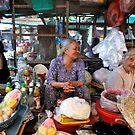 Two old friends share a joke. Vung Tau, Vietnam by Sheldon Levis