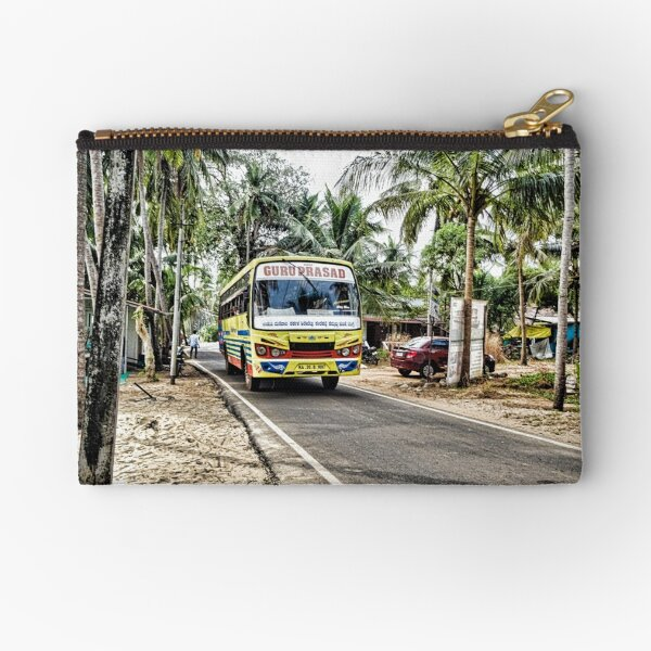 Colourful bus in rural Indian village in Coastal India Zipper Pouch