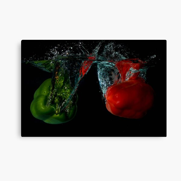 Green and Red Bell Sweet Peppers Dropped Into Water Canvas Print