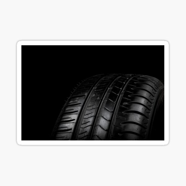 Car tyre isolated on a black background Sticker
