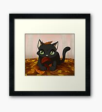 Kitty playing in autumn leaves Framed Print