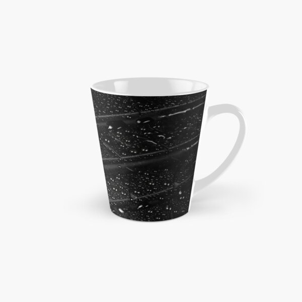 Close up view of car tyre isolated on a black background Tall Mug