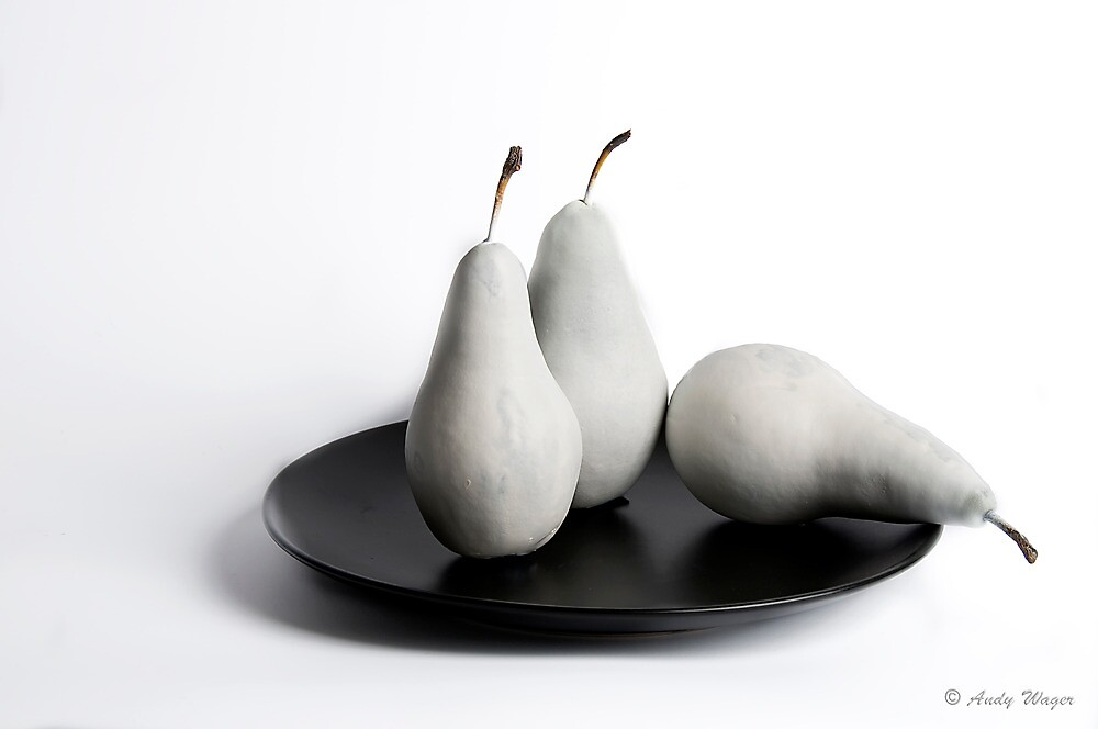 white pears on black plate by andyw