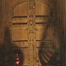 temple door and shadow  by richard  webb