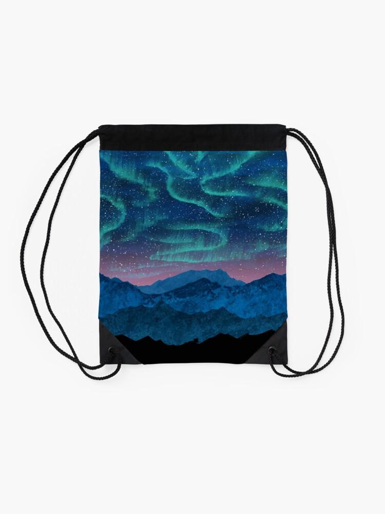 Alternate view of Aurora borealis over mountains Drawstring Bag