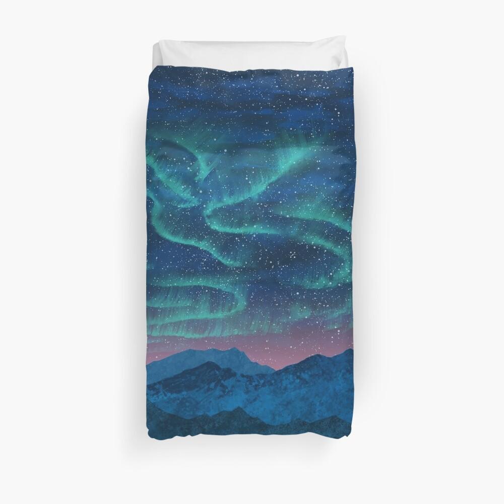 Aurora borealis over mountains Duvet Cover