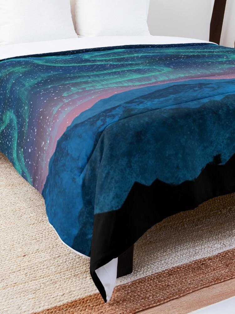 Alternate view of Aurora borealis over mountains Comforter