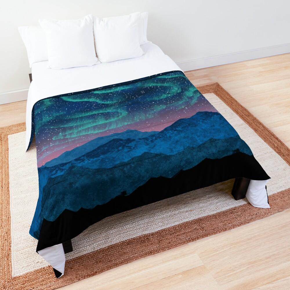Aurora borealis over mountains Comforter