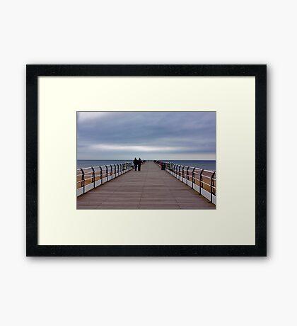 Walking on the Pier Framed Print
