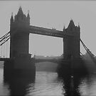London tower bridge in the fog by EblePhilippe