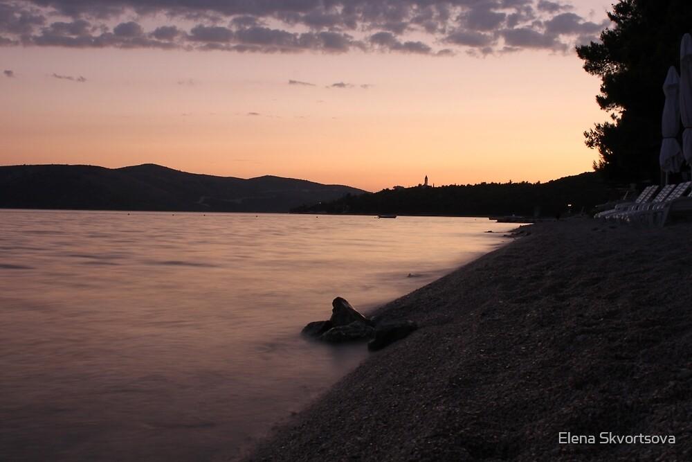 Sunset on the beach by Elena Skvortsova