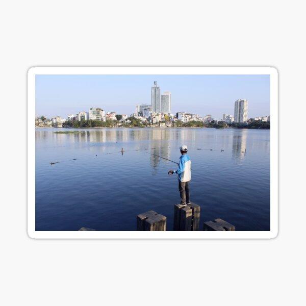 Vietnamese man fishing in Truc Bach Lake, Hanoi Sticker