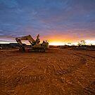PC1250 Excavator - Sunset At Emu Flats WA by Chris Paddick