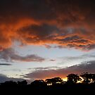 Sunset storm clouds by James  Kerr