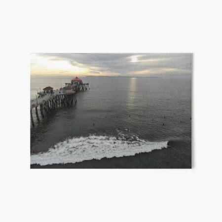 Surfers at Sunset Art Board Print
