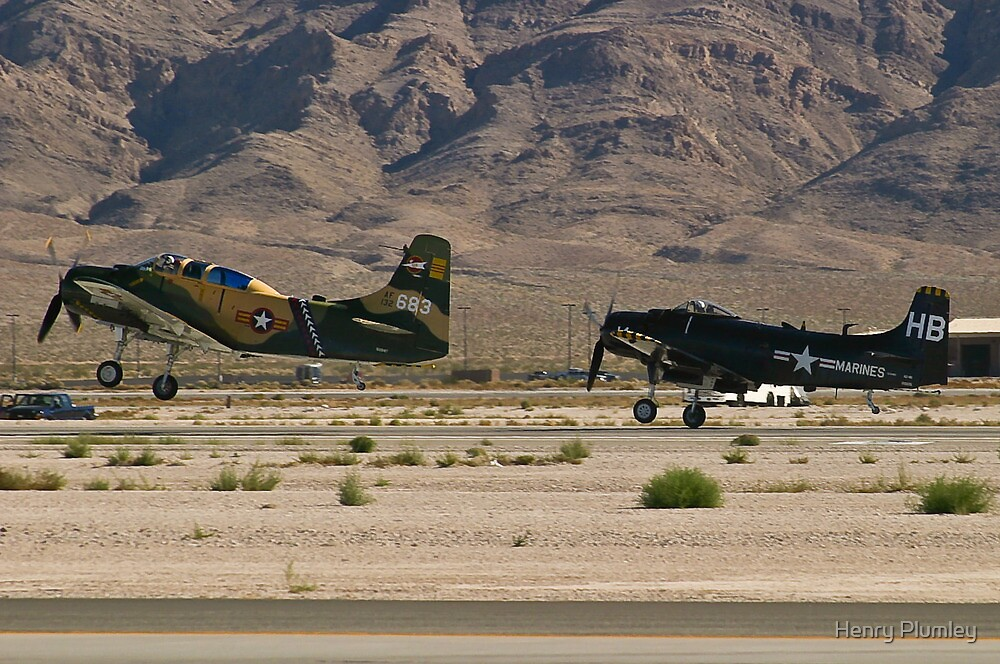 Pair of A-1 Skyraiders take off. by Henry Plumley