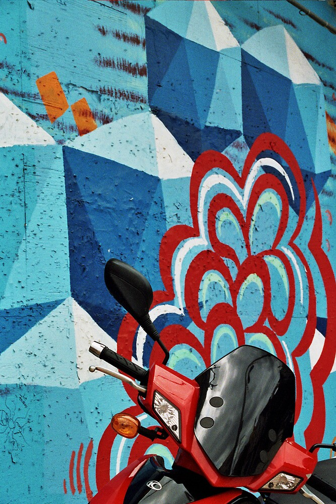Red Motorcycle on Graffiti Wall by jamiecwagner