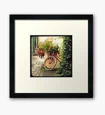 La bicyclette aux Géraniums Framed Print