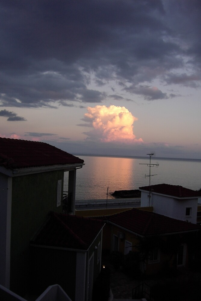 Sun reflection caught  on cloud - Skala Kafelonia Greece by mikequigley