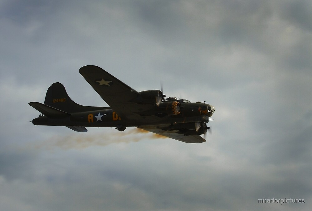 B17 flying well despite the engine fire by miradorpictures