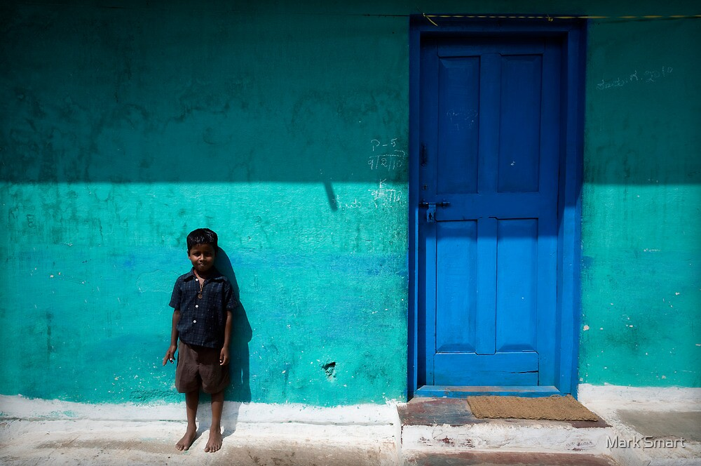 Boy by blue door by Mark Smart