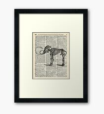Mammoth Elephant Bones.Skeleton over a Antique Dictionary Book page Framed Print