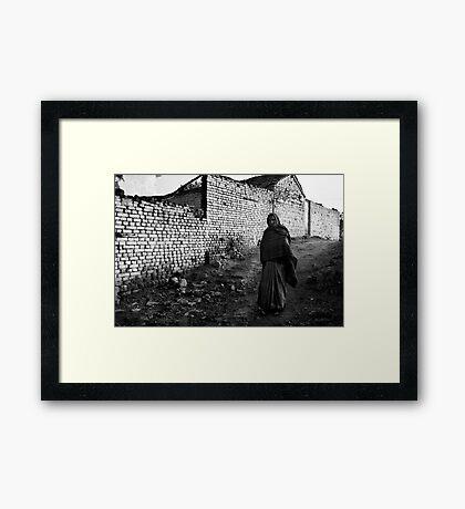 Woman Walking Against a White Wall Framed Print