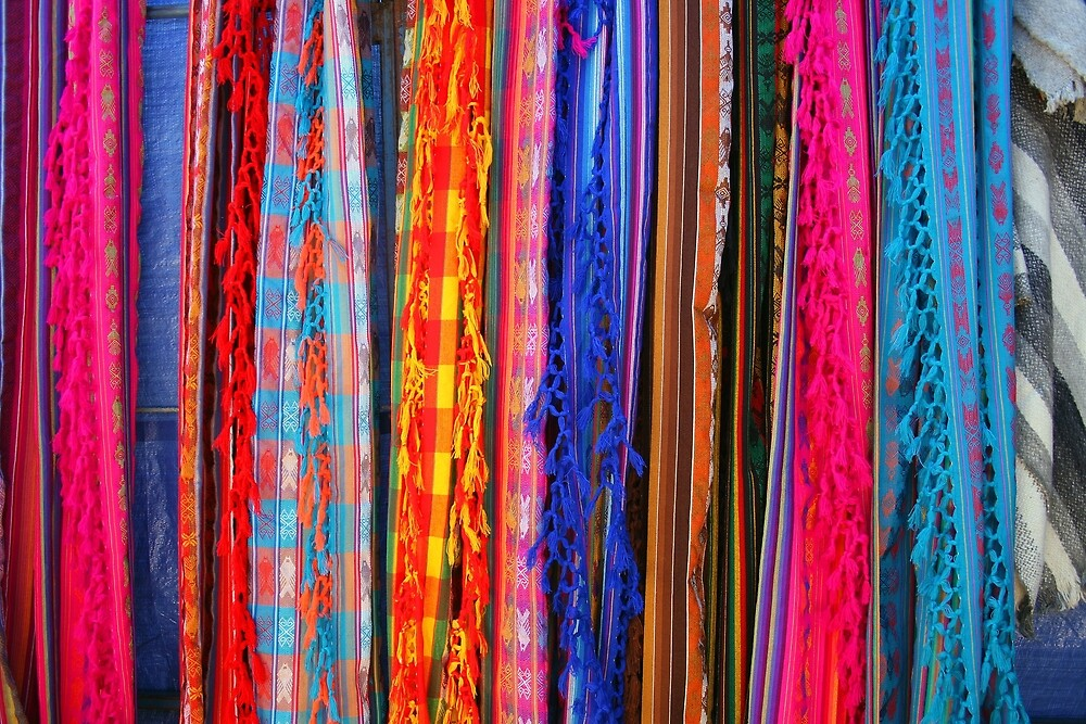 Shawls Hanging at the Outdoor Craft Market in Otavalo by rhamm