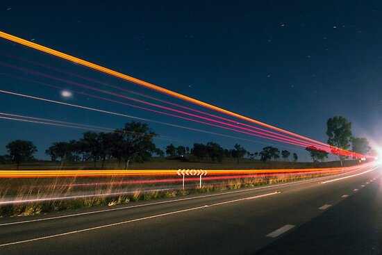 Light trails at night with flare by Rob D