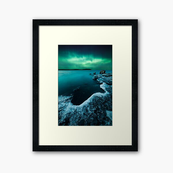 Ice on the lake shore and northern lights landscape Framed Art Print