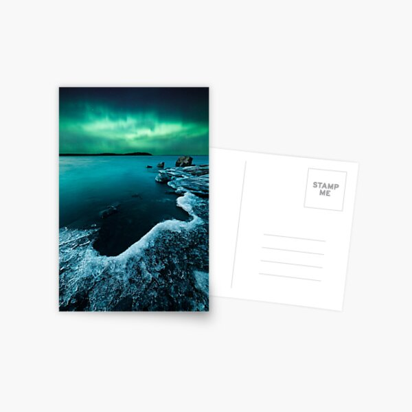 Ice on the lake shore and northern lights landscape Postcard