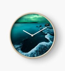 Ice on the lake shore and northern lights landscape Clock