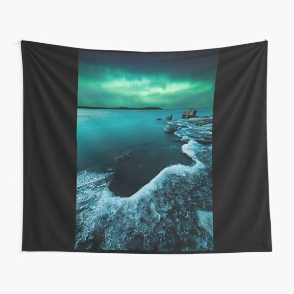 Ice on the lake shore and northern lights landscape Tapestry