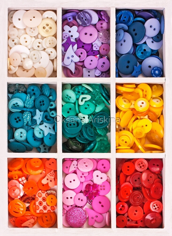 multicolor buttons  for handicrafts in box isolated on white by Oksana Ariskina