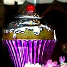 Cupcake in the window. by Livvy Young