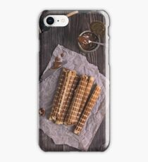 Homemade waffles with waffle iron on wooden table iPhone Case/Skin