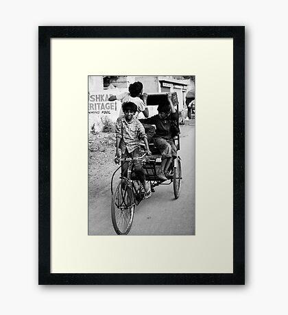 Boys playing on rickshaw  Framed Print