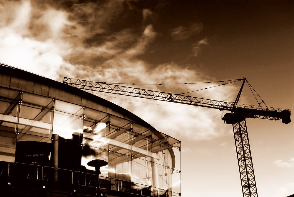 Waterfront Hall reflection and crane, Belfast (sepia) by Chris Millar