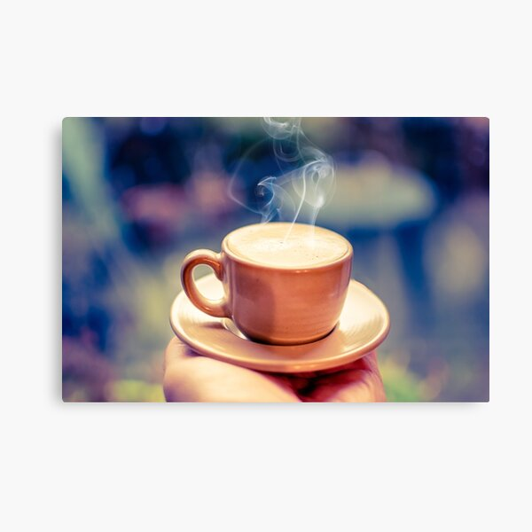 Hot Espresso in palm of hand Canvas Print