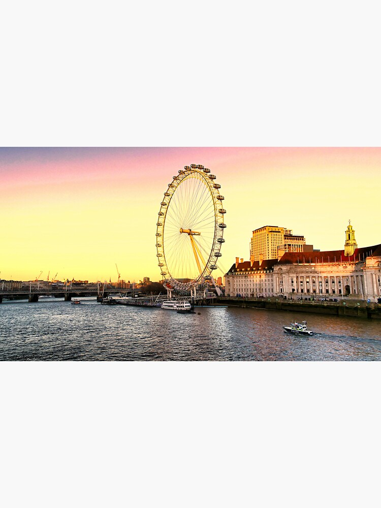 London Eye and the buildings next to River Thames by santoshputhran