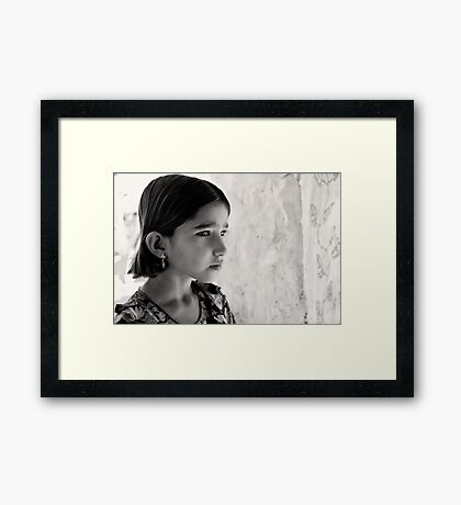 Girl in thought Framed Print